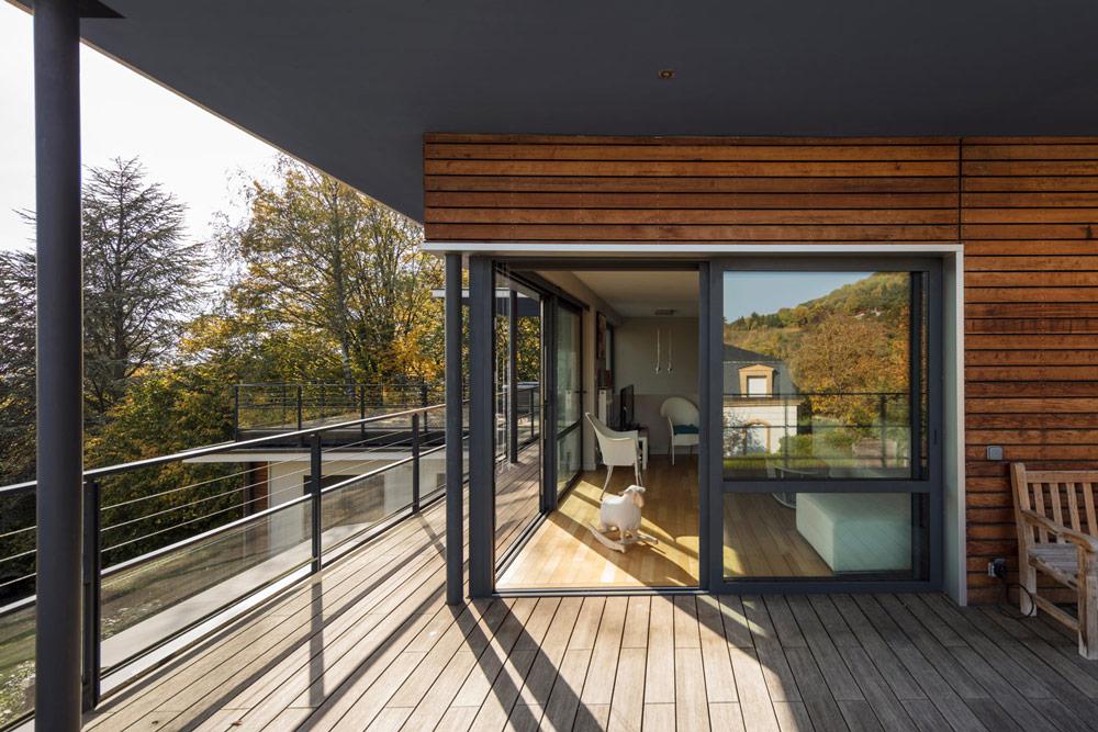 Baies vitrées : Coulissant aluminium sur terrasse