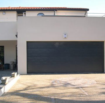 Porte de garage : Porte de garage sectionnelle motorisée